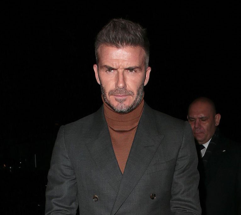 david beckham wearing a turtleneck with a suit
