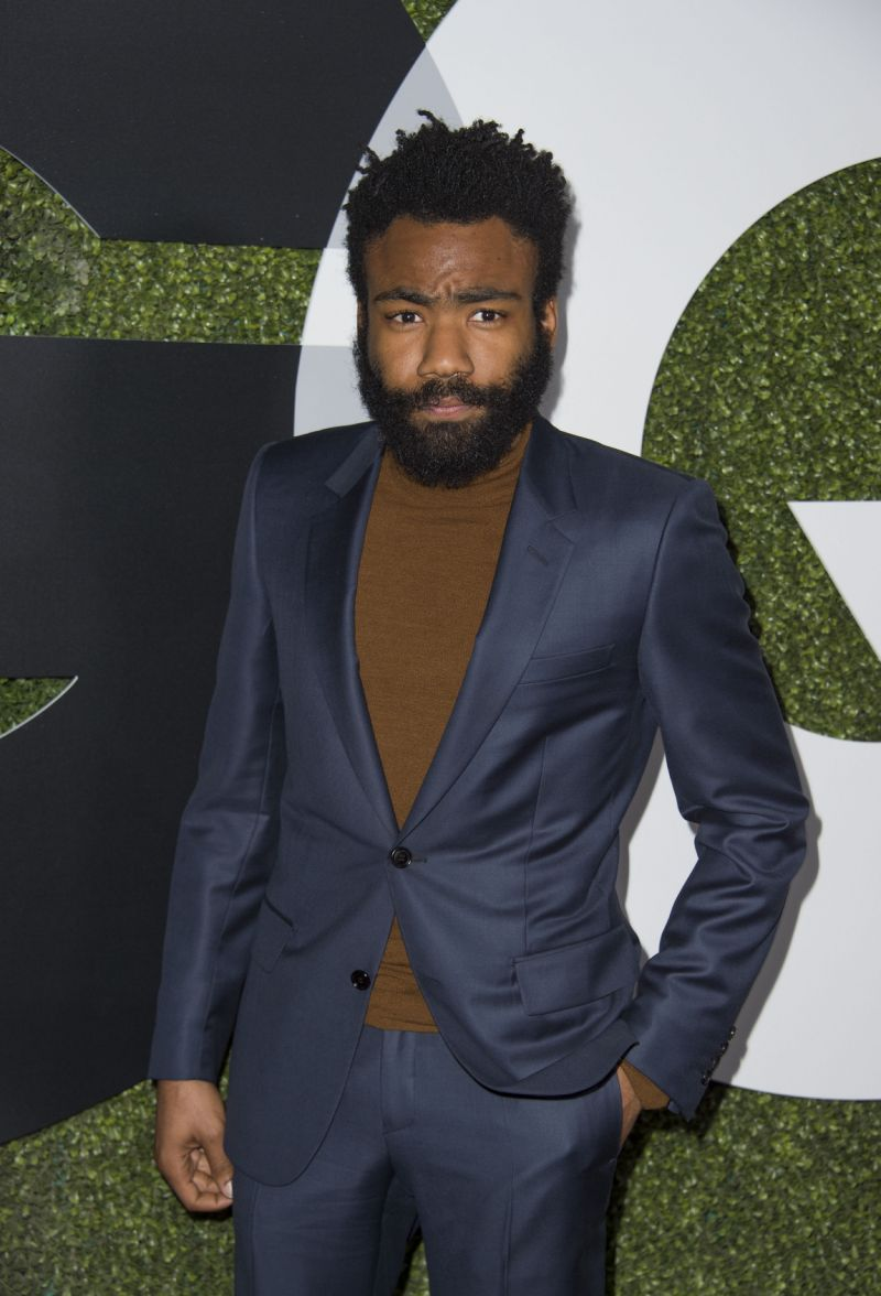 donald glover wearing a turtleneck with a suit