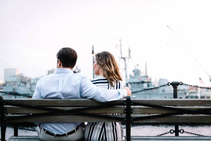 couple, stylish couple, man and woman sitting on a bench,