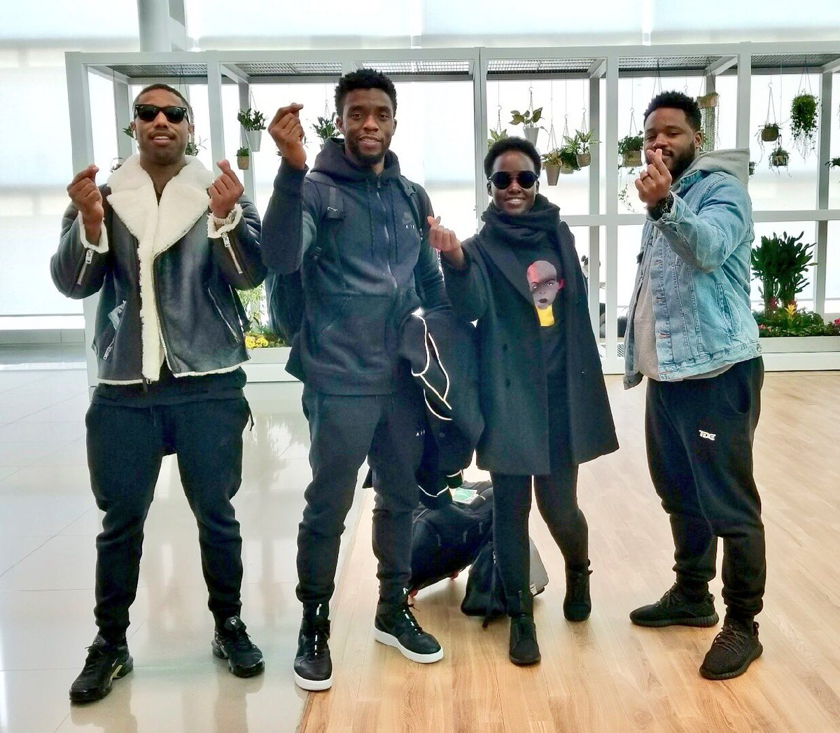 Black Panther cast airport travel style