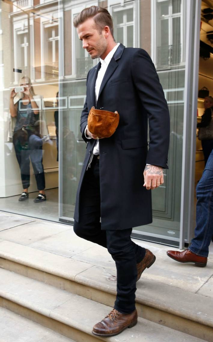 Day 15  Wear your burliest boots with a suit. Pin It 76cb5c5acb6c1