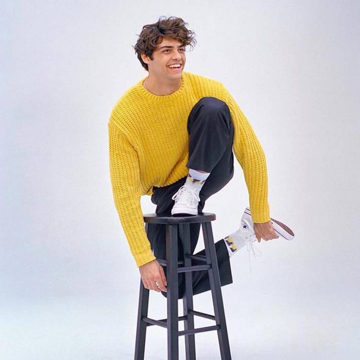 noah centino wearing yellow sweater