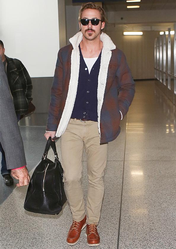 Ryan Gosling wearing shearling jacket at airport