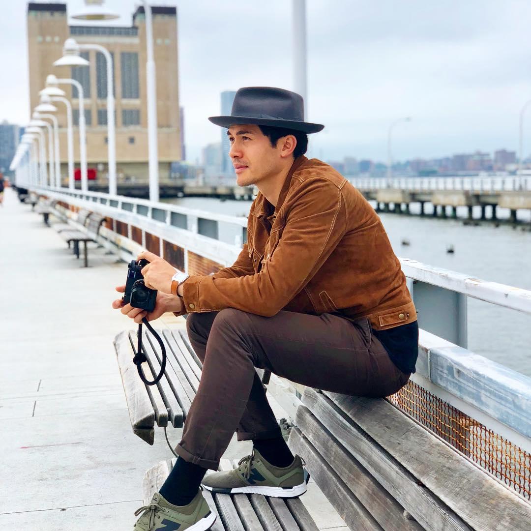henry golding holding camera