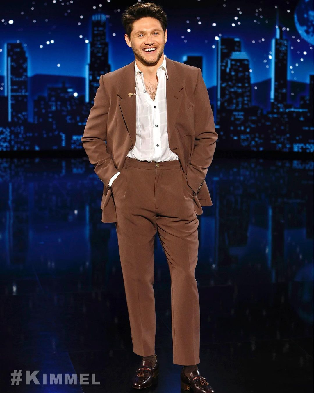 Niall Horran in brown suit